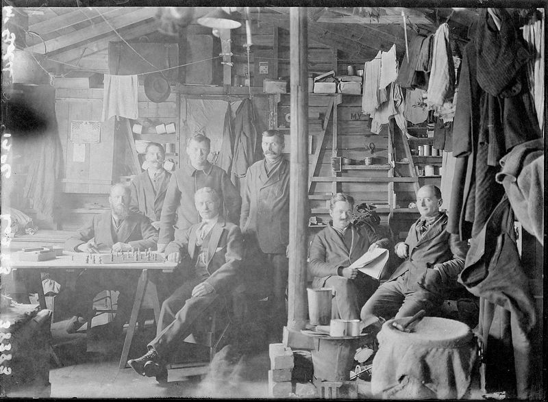 Men in hut. Note use of every available space. ©MNH
